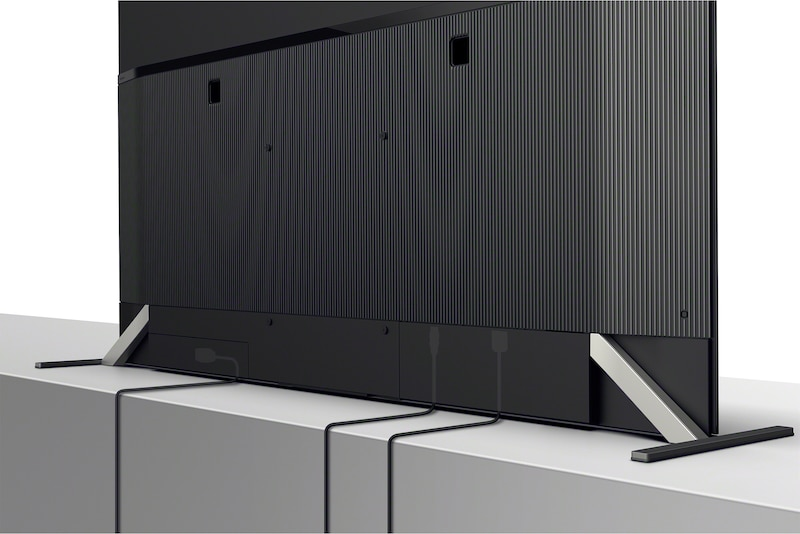 Изображение телевизора сзади, где показано расположение кабелей